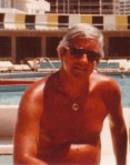 "My father ""working"" by the pool on Miami Beach--"