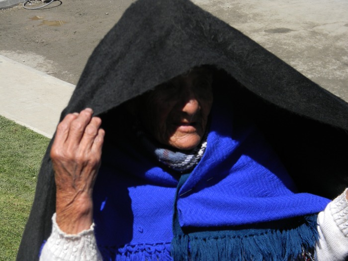 A local grandmother protecting herself from the intense sun.