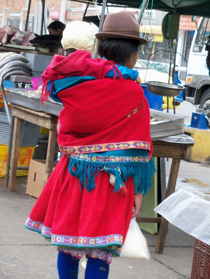 Hope you enjoy this woman's vibrant everyday dress.  Don't you love the baby on her back?