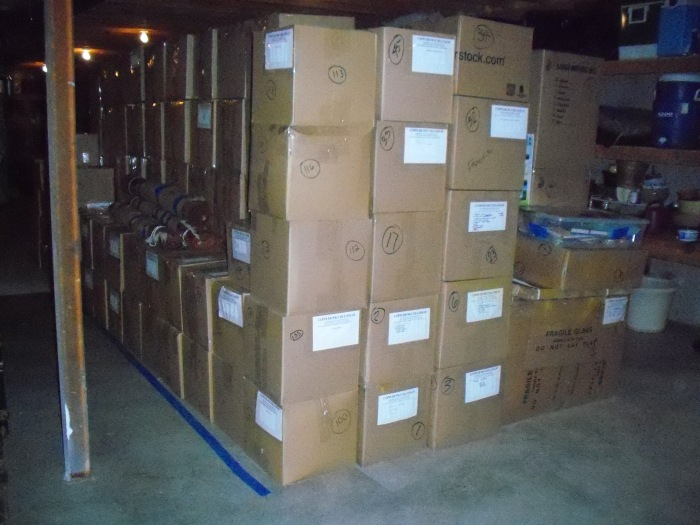 Our boxes, packed and stacked in Sara's father's basement--Lexington, Kentucky--