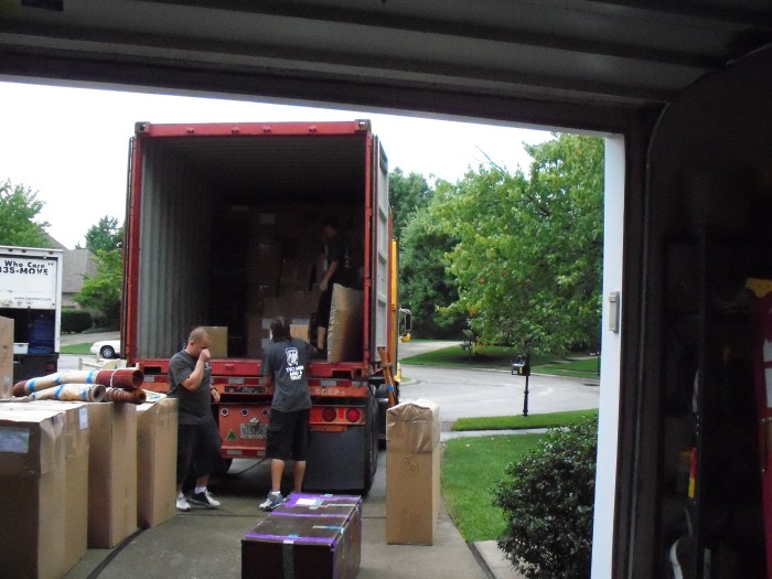 Container being loaded with our 213 boxes--