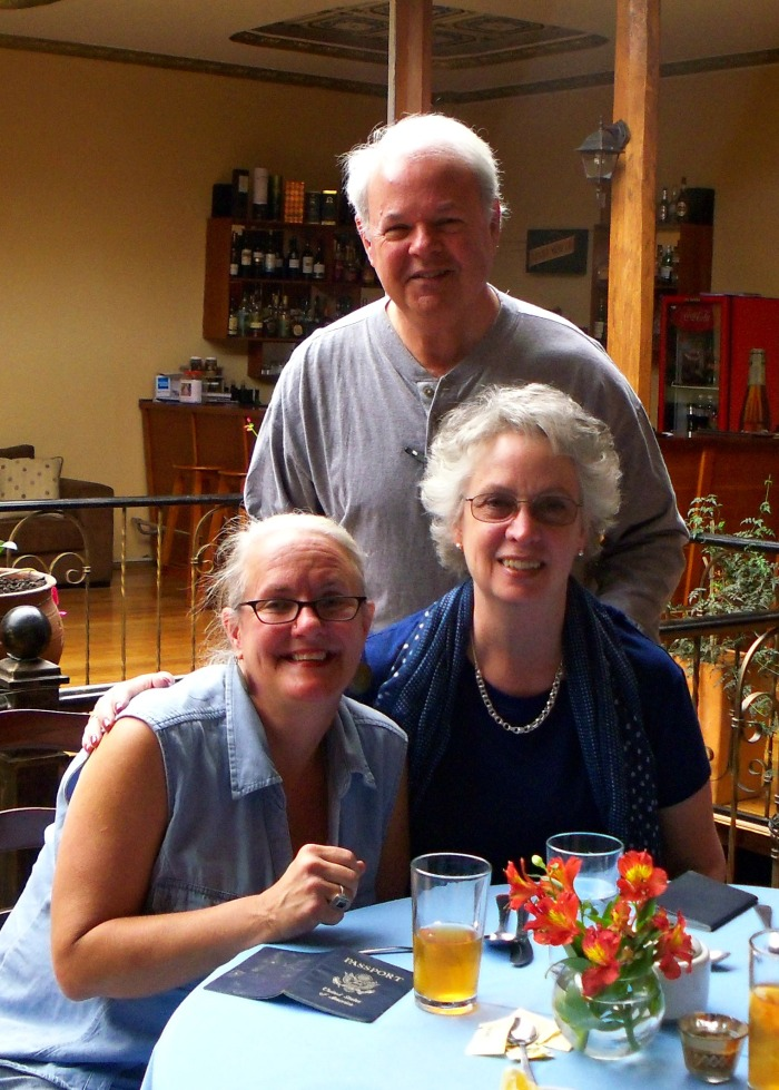Kathy celebrating visa approval with Wayne and Judith Erminger at California Kitchen.