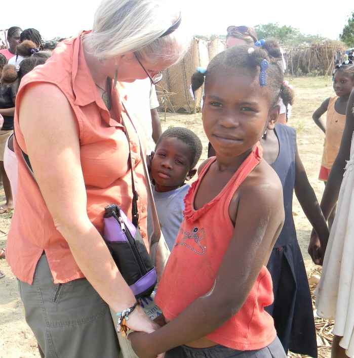 Kathy with Haitian children, March 2010--