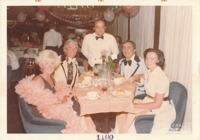 My parents are on the left--my mother in the feather boa.