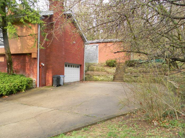 """""""I"""" family garage door and driveway.  The secret room was just to the left, inside the garage door."""