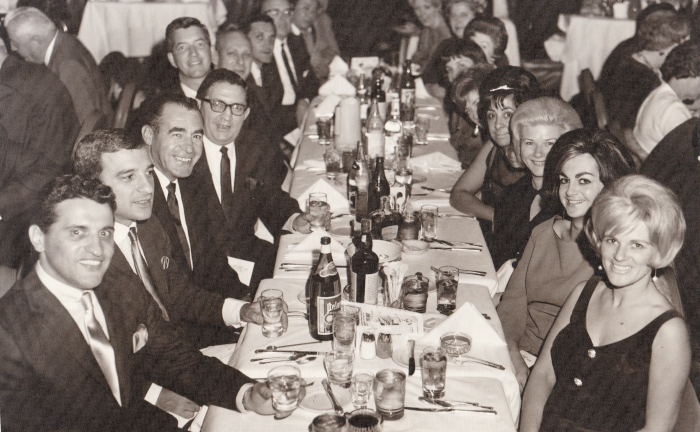 "My parents in Vegas with the ""I""s (couple seated in the foreground) during the 1960s. My mother, though difficult to see, is seated across from my father (5th fellow on left)."