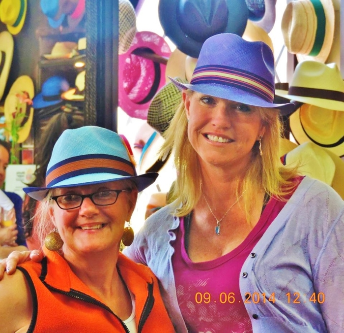Posing while Panama hat shopping--