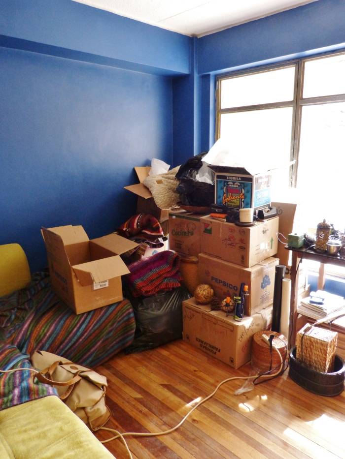 Boxes piled high in Sara's new office--