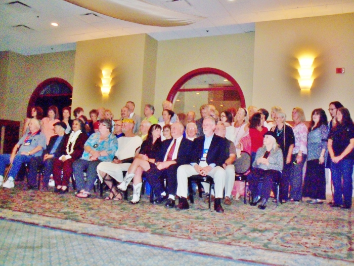 Inductees into the World Massage Hall of Fame over the past decade. My Godmother is seated in the second row, far right, holding a photo of Raul from my cell phone.